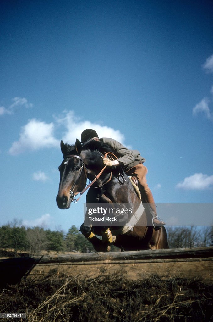 US Prix des Nations Walter Staley Jr in action aboard Mud Dauber leaping over obstacle during practice session before competition at the Cotton Patch...