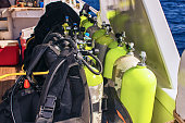 Equipment for scuba diving on boat of ship. Picture of aqualungs for diving.