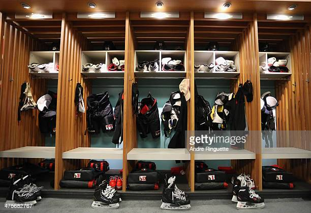 Equipment hangs in the stalls of the Ottawa Senators dressing room during the load in for the 2014 Tim Horton NHL Heritage Classic game between the...