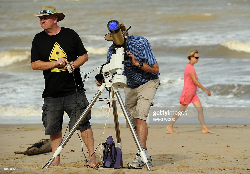 Equipment is made ready to be used for a direct feed of the total solar eclipse to NASA on the foreshore at Palm Cove in Tropical North Queensland on November 13, 2012. Tens of thousands of people were flocking to Australia's laid-back tropical north for a total solar eclipse on November 14, a phenomenon officials say has not been seen in the region in 1,300 years. AFP PHOTO / Greg WOOD