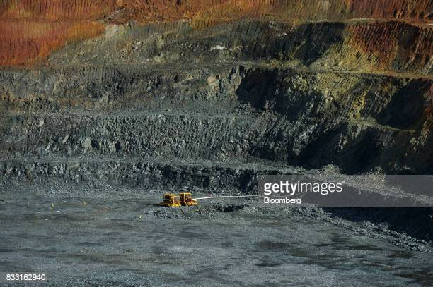 Equipment operates in the Neptune open pit mine at the St Ives Gold Mine operated by Gold Fields Ltd in Kambalda Australia on Wednesday Aug 9 2017...