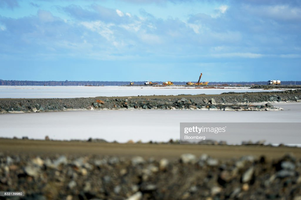 Equipment operates on a salt lake at the St Ives Gold Mine operated by Gold Fields Ltd. in Kambalda, Australia, on Wednesday, Aug. 9, 2017. Global gold deals have also slowed, declining to $19.8 billion in 2016 from $22.8 billion a year earlier, according to data complied by Bloomberg.Photographer: Carla Gottgens/Bloomberg via Getty Images