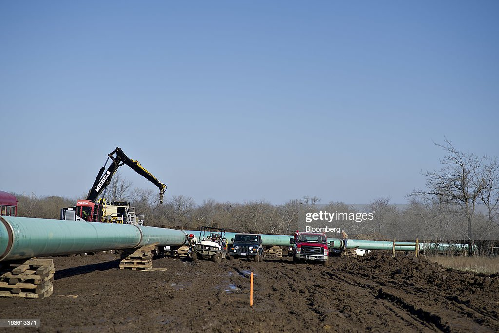 Equipment sits near a section of pipeline during construction of the Gulf Coast Project pipeline in Atoka, Oklahoma, U.S., on Monday, March 11, 2013. The Gulf Coast Project, a 485-mile crude oil pipeline being constructed by TransCanada Corp., is part of the Keystone XL Pipeline Project and will run from Cushing, Oklahoma to Nederland, Texas. Photographer: Daniel Acker/Bloomberg via Getty Images