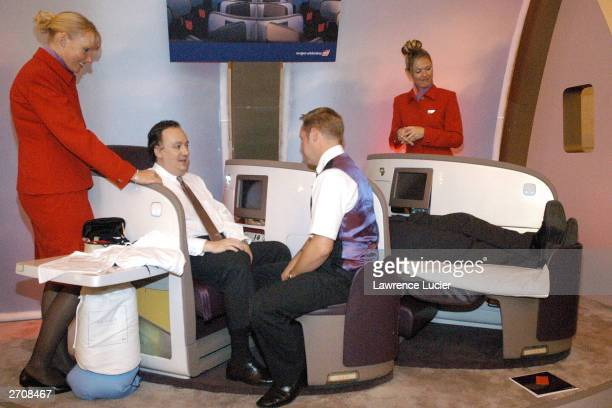 Equity analyst Andreas Dirnagl is shown Virgin Atlantic Airways Upper Class Suite by Virgin Atlantic staff at Poplular Science's Best Of What's New...