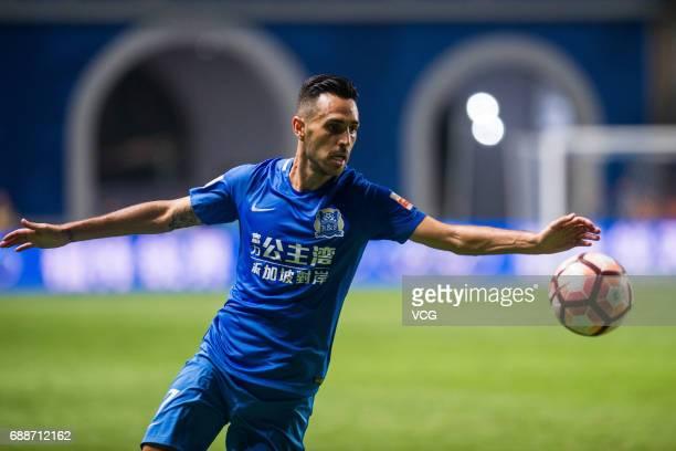 Eran Zahavi of Guangzhou RF drives the ball during the 11th round match of China Super League between Guangzhou RF and Shanghai Shenhua at Yuexiushan...