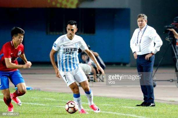 Eran Zahavi of Guangzhou RF drives the ball during the 12th round match of 2017 Chinese Football Association Super League between Henan Jianye and...