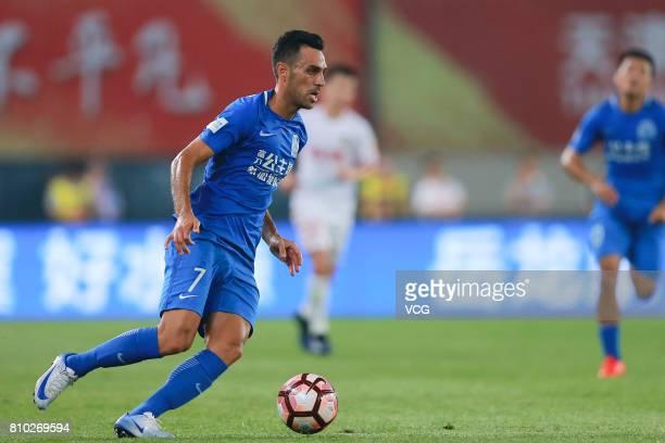 Eran Zahavi of Guangzhou RF drives the ball during the 16th round match of 2017 Chinese Football Association Super League between Tianjin Quanjian...