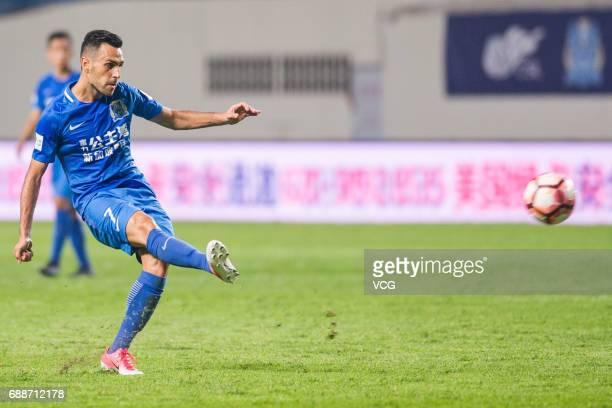 Eran Zahavi of Guangzhou RF shoots the ball during the 11th round match of China Super League between Guangzhou RF and Shanghai Shenhua at Yuexiushan...