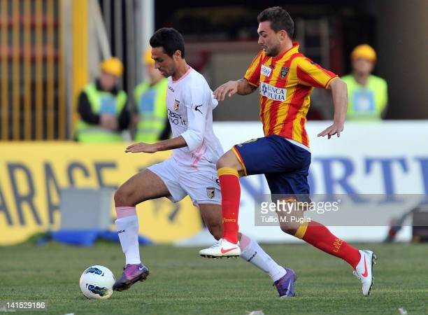 Eran Zahavi of Palermo and Daniele Corvia of Lecce compete for a header during the Serie A match between US Lecce and US Citta di Palermo at Stadio...