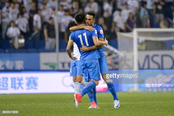 Eran Zehavi of Guangzhou RF celebrates a point with Jiang Zhipeng of Guangzhou RF during 2017 Chinese Super League 14th round match between Tianjin...