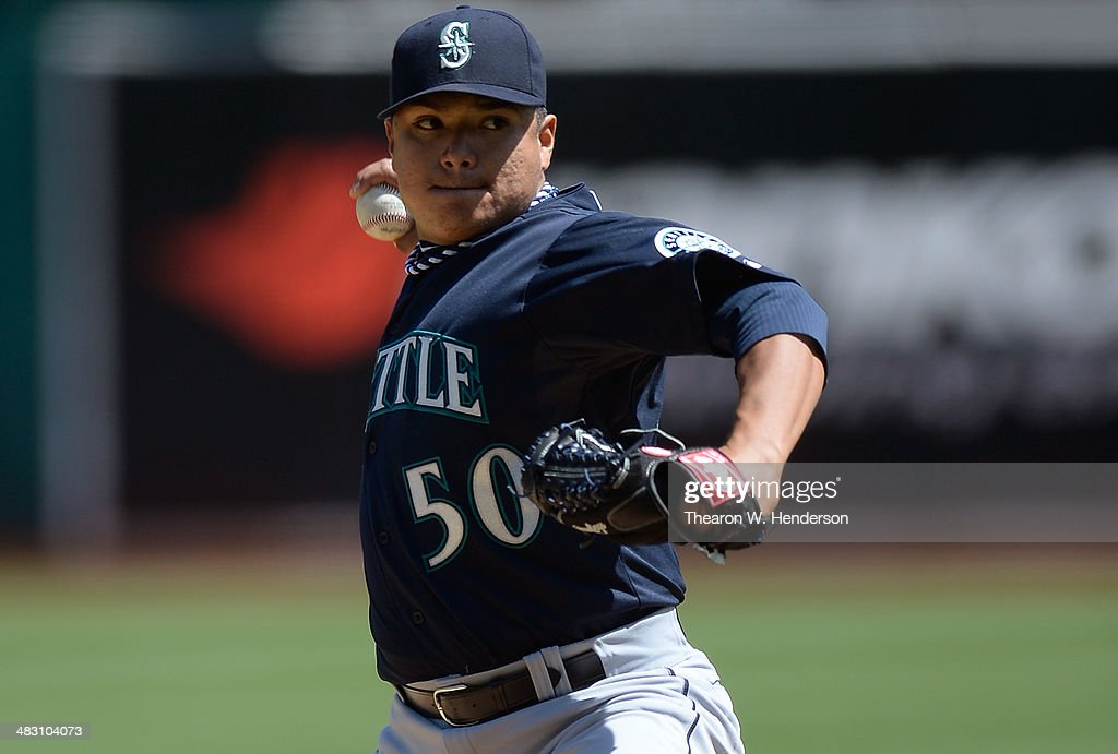 Erasmo Ramirez #50 of the Seattle Mariners pitches against the Oakland Athletics in the bottom of the first inning at O.co Coliseum on April 6, 2014 in Oakland, California.