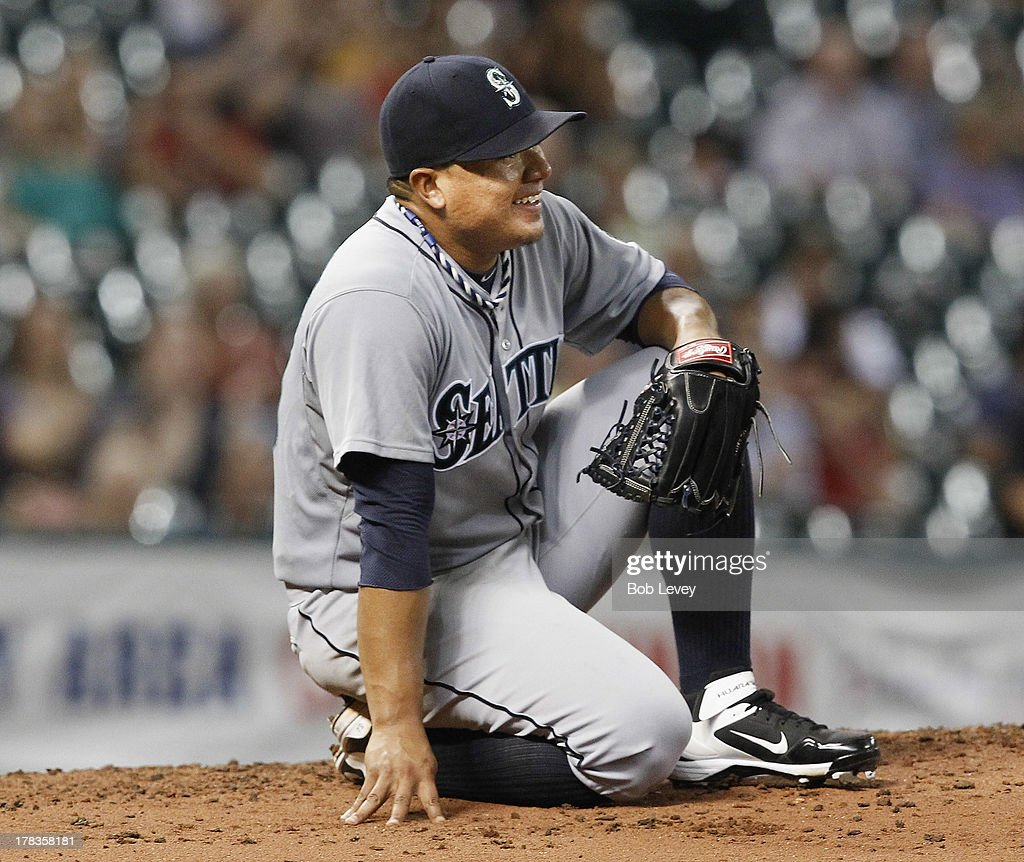 <a gi-track='captionPersonalityLinkClicked' href=/galleries/search?phrase=Erasmo+Ramirez&family=editorial&specificpeople=234687 ng-click='$event.stopPropagation()'>Erasmo Ramirez</a> #50 of the Seattle Mariners takes a moment after taking a line drive off his foot off the bat of Robbie Grossman #19 of the Houston Astros in the fifth inning at Minute Maid Park on August 29, 2013 in Houston, Texas.