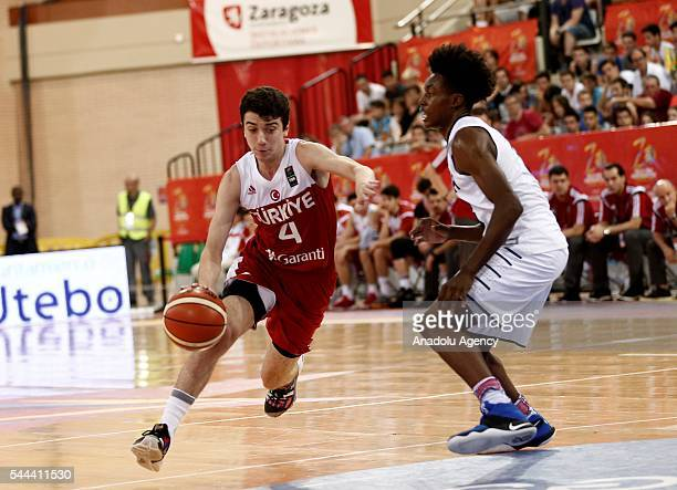 Eray Akyuz of Turkey is in action against Collin Sexton of USA during the FIBA U17 Men's World Championship gold medal game between USA and Turkey at...