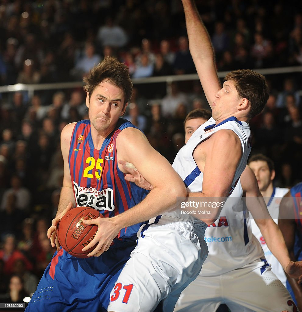 Erazem Lorbek, #25 of FC Barcelona Regal in action with <a gi-track='captionPersonalityLinkClicked' href=/galleries/search?phrase=Viktor+Khryapa&family=editorial&specificpeople=209061 ng-click='$event.stopPropagation()'>Viktor Khryapa</a>, #31 of CSKA Moscow during the 2012-2013 Turkish Airlines Euroleague Regular Season Game Day 10 between FC Barcelona Regal v CSKA Moscow at Palau Blaugrana on December 13, 2012 in Barcelona, Spain.