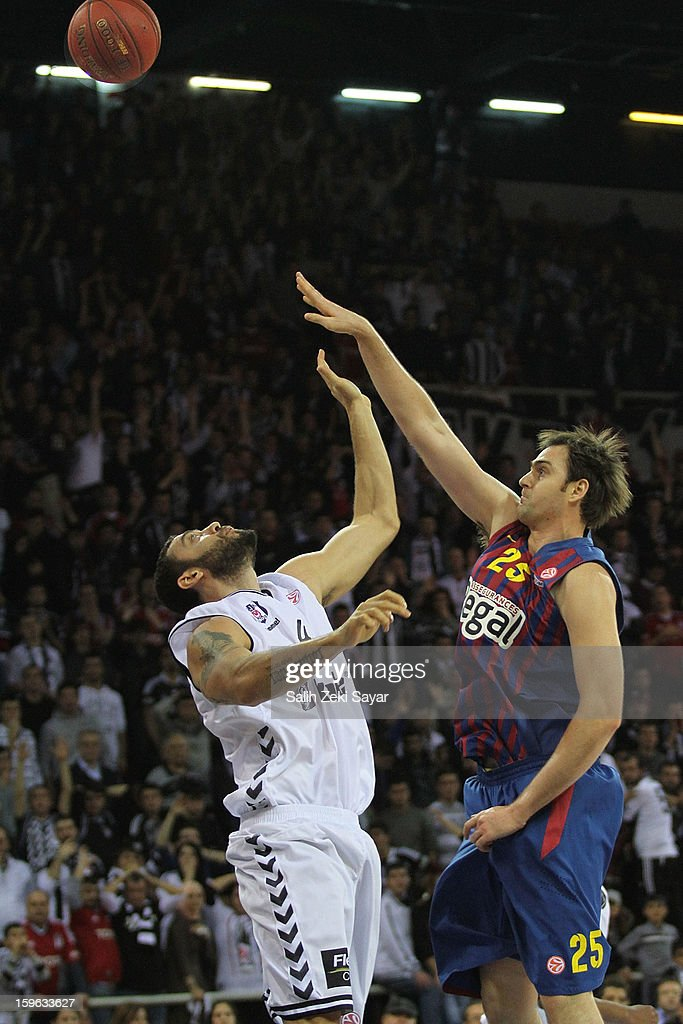 Erazem Lorbek #25 of FC Barcelona Regal competes with Cevher Ozer #41 of Besiktas JK Istanbul during the 2012-2013 Turkish Airlines Euroleague Top 16 Date 4 between Besiktas JK Istanbul v FC Barcelona Regal at Abdi Ipekci Sports Arena on January 17, 2013 in Istanbul, Turkey.