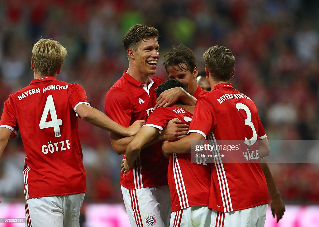 Erdal Ozturk of Bayern Munich is congratulated by teammates after scoring the opening goal during the pre season friendly match between Bayern...