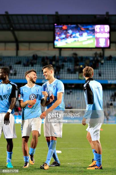 Erdal Rakip and Alexander Jeremejeff celebrate after the Allsvenskan match between Malmo FF and Kalmar FF at Swedbank Stadion on August 11 2017 in...