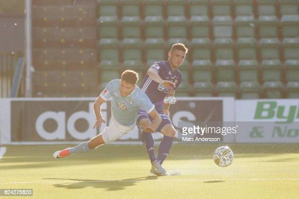 Erdal Rakip of Malmo FF and Kristinn Freyr Sigurdsson of GIF Sundsvall during the Allsvenskan match between GIF Sundsvall and Malmo FF at...