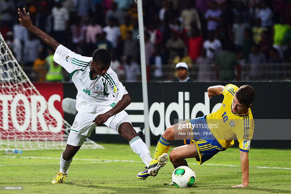 Erdal Rakip (R) of Sweden is challenged by Kelechi Iheanacho of Nigeria during the FIFA U-17 World Cup UAE 2013 Semi Final match between Sweden and Nigeria at Al Rashid Stadium on November 5, 2013 in Dubai, United Arab Emirates.