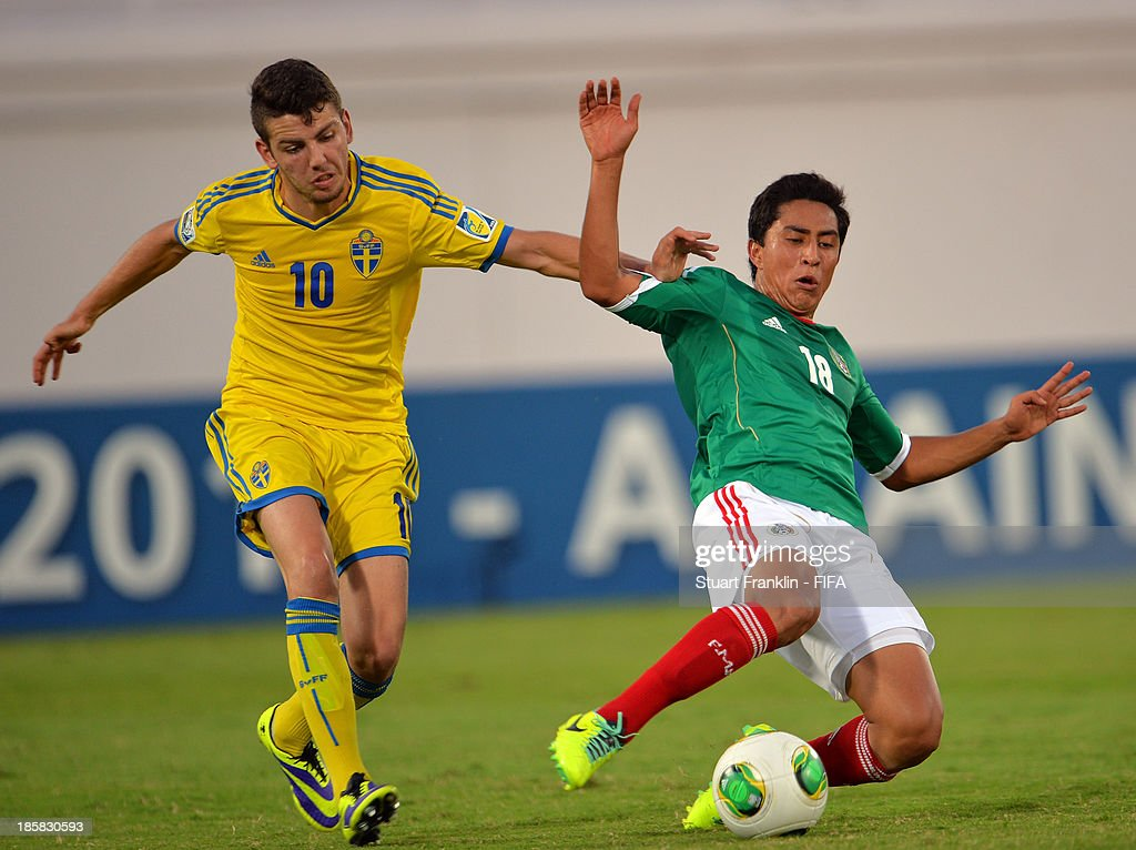 Erdal Rakip of Sweden is challenged by Omar Govea of Mexico during the FIFA U 17 World Cup group F match between Sweden and Mexico at Khalifa Bin Zayed Stadium on October 25, 2013 in Al Ain, United Arab Emirates.