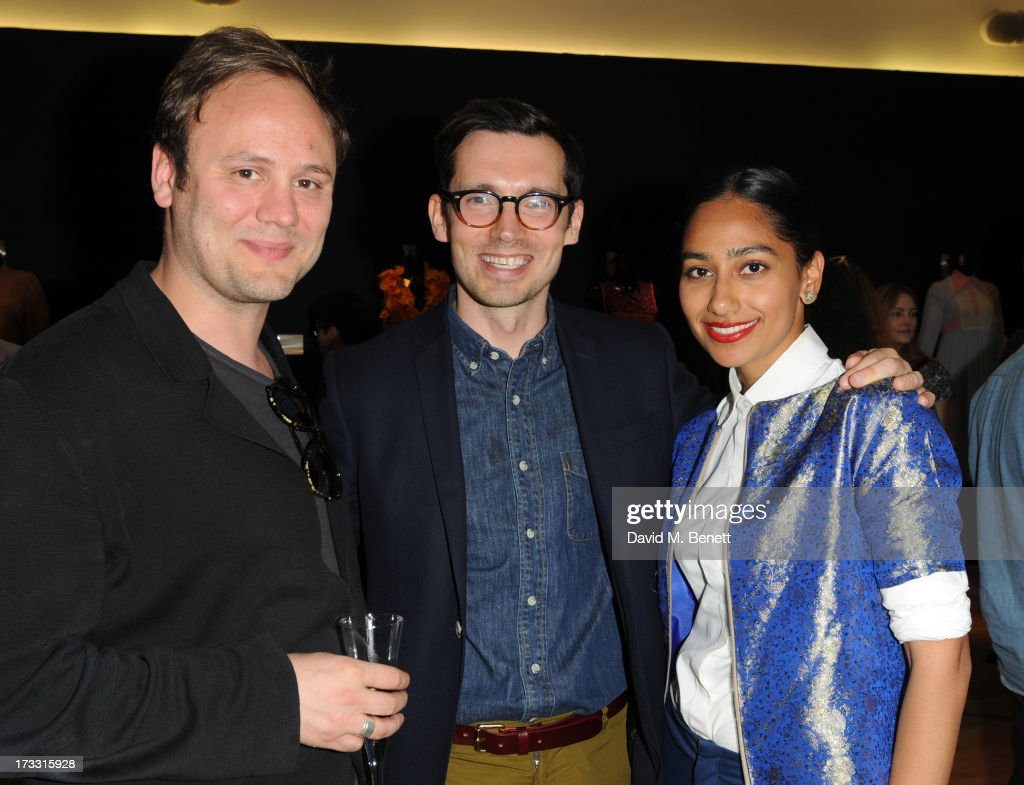 Erdem Moralioglu (centre) attend the private view of 'The Suzy Menkes Collection: In My Fashion' at Christie's on July 11, 2013 in London, England.