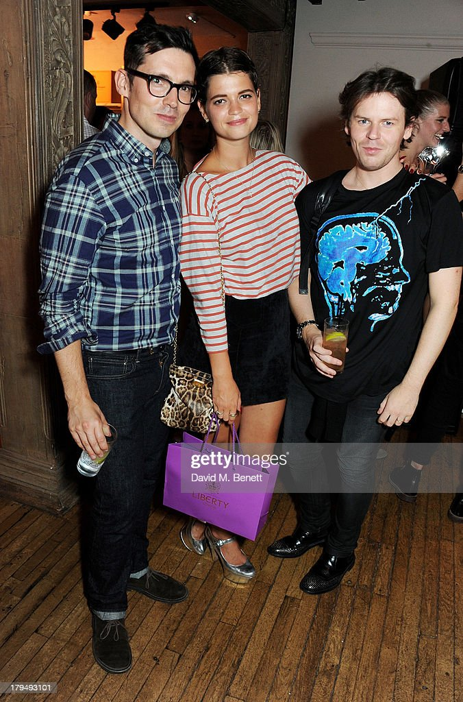 Erdem Moralioglu, Pixie Geldof and Christopher Kane attend the launch of Alexa Chung's first book 'It' at Liberty on September 4, 2013 in London, England.