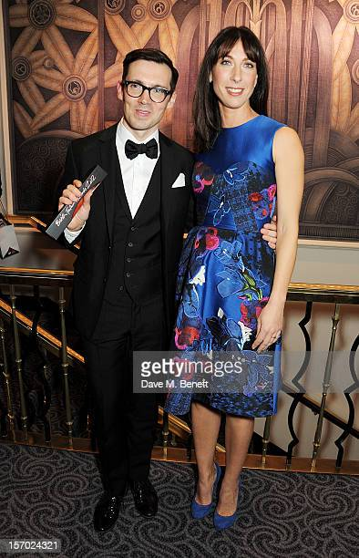 Erdem Moralioglu winner of the New Establishment award poses with Samantha Cameron at the British Fashion Awards 2012 at The Savoy Theatre on...