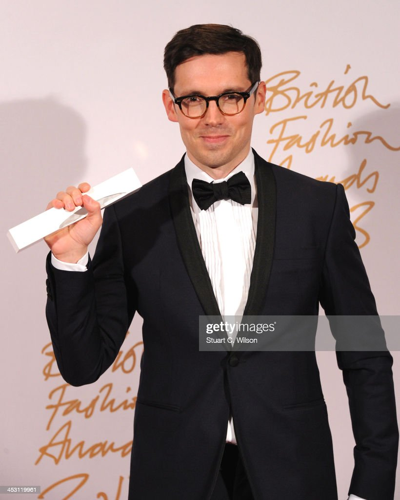 Erdem Moralioglu with the Red Carpet Designer of the Year Award poses in the winners room at the British Fashion Awards 2013 at London Coliseum on December 2, 2013 in London, England.