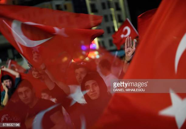 TOPSHOT Erdogan supporters wave Turkish flags as they gather at Taksim square on July 21 2016 during a rally in Istanbul following the failed...