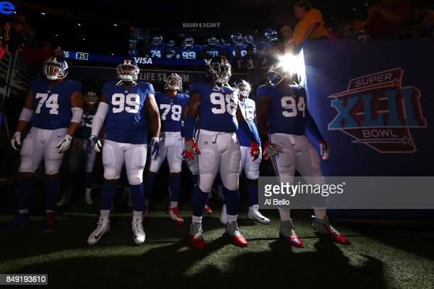 Ereck Flowers Robert Thomas Damon Harrison and Dalvin Tomlinson of the New York Giants wait to take the field prior to their game against the Detroit...
