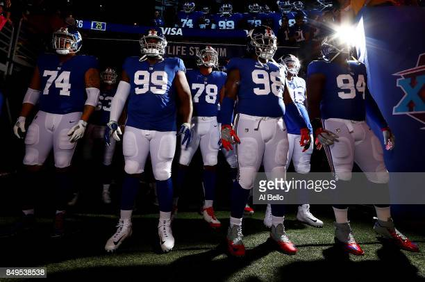 Ereck Flowers Robert Thomas Romeo Okwara Damon Harrison and Dalvin Tomlinson of the New York Giants wait to take the field prior to their game...
