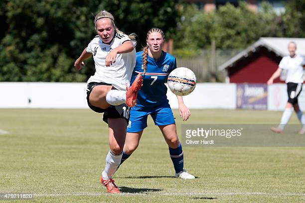 Ereleta Memeti of Germany and Rannveig Bjarnadottir of Iceland compete for the ball during the Girl's Nordic Cup match between U16 Iceland and U16...