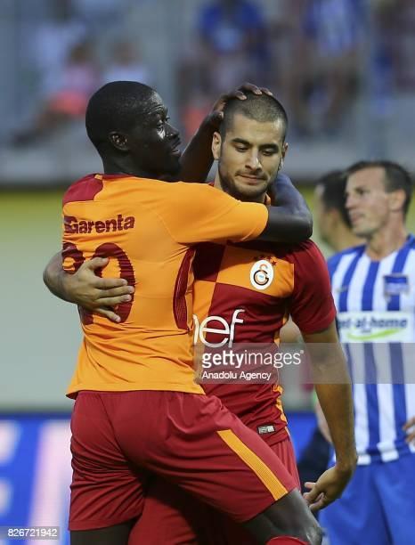 Eren Derdiyok of Galatasaray celebrates with Badou Ndiaye after scoring a goal during a friendly match between Galatasaray and Hertha Berlin as part...