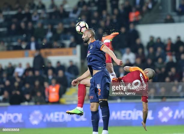 Eren Derdiyok of Galatasaray in action against Yalcin Ayhan of Medipol Basaksehir during the Turkish Spor Toto Super Lig football match between...