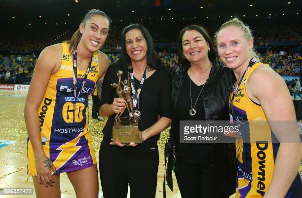 Erena Mikaere Coach Noeline Taurura of the Sunshine Coast Lightning and Laura Langman pose with the Suncorp Super Netball trophy after winning the...