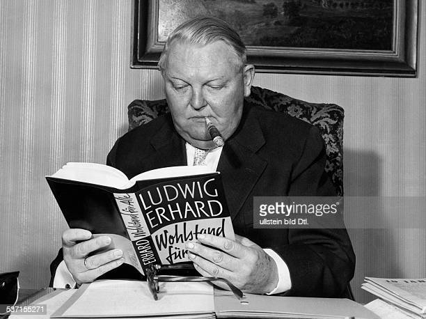 Erhardt Ludwig Politician CDU Germany Federal Minister of Economy 19491963 Portrait with his book 'Prosperity for All' 1957 Vintage property of...