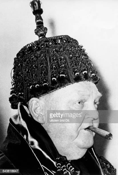 Erhardt Ludwig Politician CDU Germany*04021897Federal Minister of Economy 19491963 Portrait with mortarboard from the University of Coimbra which...