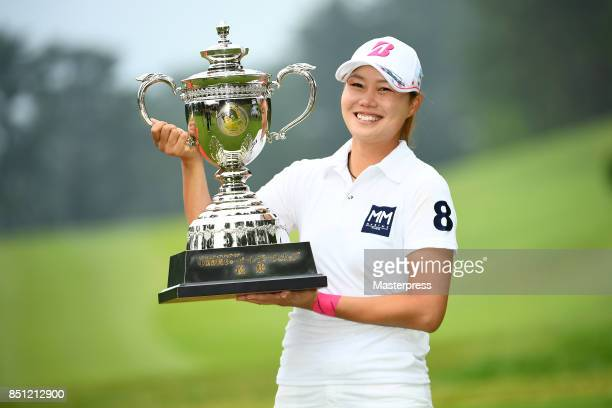Eri Fukuyama of Japan poses with the trophy after winning the Chugoku Shimbun Choopi Ladies Cup at the Geinan Country Club on September 22 2017 in...