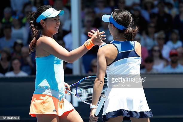 Eri Hozumi and Miyu Kato of Japan celebrate winning their first round doubles match against Ellen Perez and Olivia Tjandramulia of Australia on day...