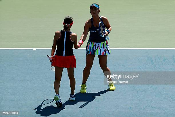 Eri Hozumi and Miyu Kato of Japan in action against Caroline Garcia and Kristina Mladenovic of France during their third round Women's Doubles match...