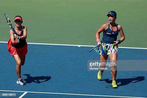 Eri Hozumi and Miyu Kato of Japan return a shot to Caroline Garcia and Kristina Mladenovic of France during their third round Women's Doubles match...