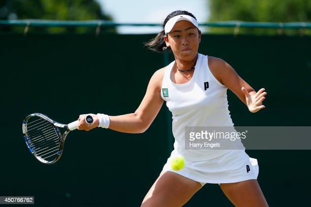 Eri Hozumi of Japan in action during her first round qualifying match against Kiki Bertens of the Netherlands on day two of the Wimbledon...