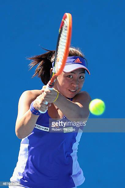 Eri Hozumi of Japan plays a backhand in her qualifying match against Renata Voracova of Czech Republic for 2015 Australian Open at Melbourne Park on...