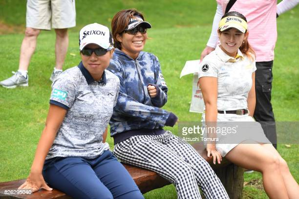 Eri Okayama Lala Anai and Kotono Kozuma of Japan smile during the first round of the meiji Cup 2017 at the Sapporo Kokusai Country Club Shimamatsu...