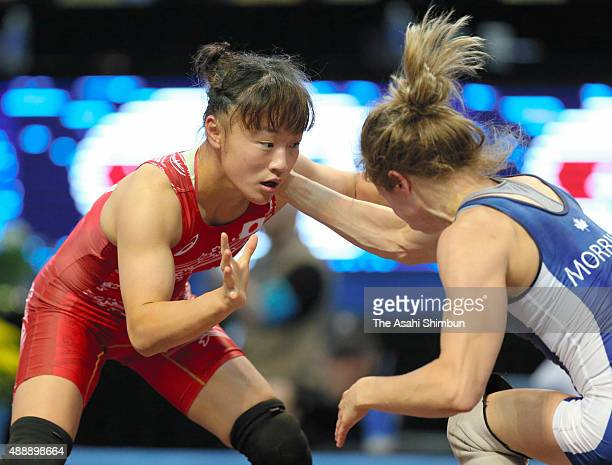 Eri Tosaka and Genevieve Morrison Haley of Canada compete in the Women's Freestyle 48kg semifinal during day three of the World Wrestling...