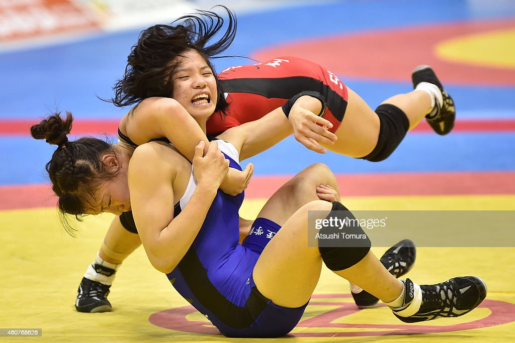 <a gi-track='captionPersonalityLinkClicked' href=/galleries/search?phrase=Eri+Tosaka&family=editorial&specificpeople=9149207 ng-click='$event.stopPropagation()'>Eri Tosaka</a> (Red) and Miho Igarashi (Blue) compete in Women's 48kg free style semi final during 2014 Emperor's Cup All Japan Wresting Championship on December 22, 2014 in Tokyo, Japan.