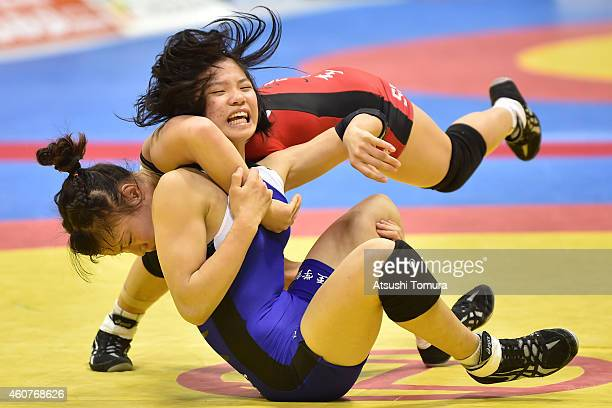 Eri Tosaka and Miho Igarashi compete in Women's 48kg free style semi final during 2014 Emperor's Cup All Japan Wresting Championship on December 22...