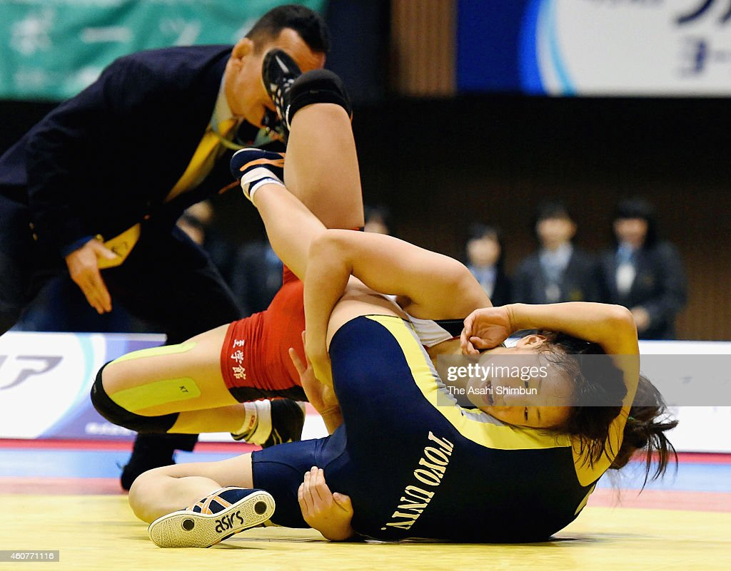 <a gi-track='captionPersonalityLinkClicked' href=/galleries/search?phrase=Eri+Tosaka&family=editorial&specificpeople=9149207 ng-click='$event.stopPropagation()'>Eri Tosaka</a> (Red) and <a gi-track='captionPersonalityLinkClicked' href=/galleries/search?phrase=Yu+Miyahara&family=editorial&specificpeople=6339675 ng-click='$event.stopPropagation()'>Yu Miyahara</a> (blue) compete in the Women's 48kg freestyle final match during day two of the 2014 Emperor's Cup All Japan Wrestling Championships at Yoyogi Gymnasium on December 22, 2014 in Tokyo, Japan.