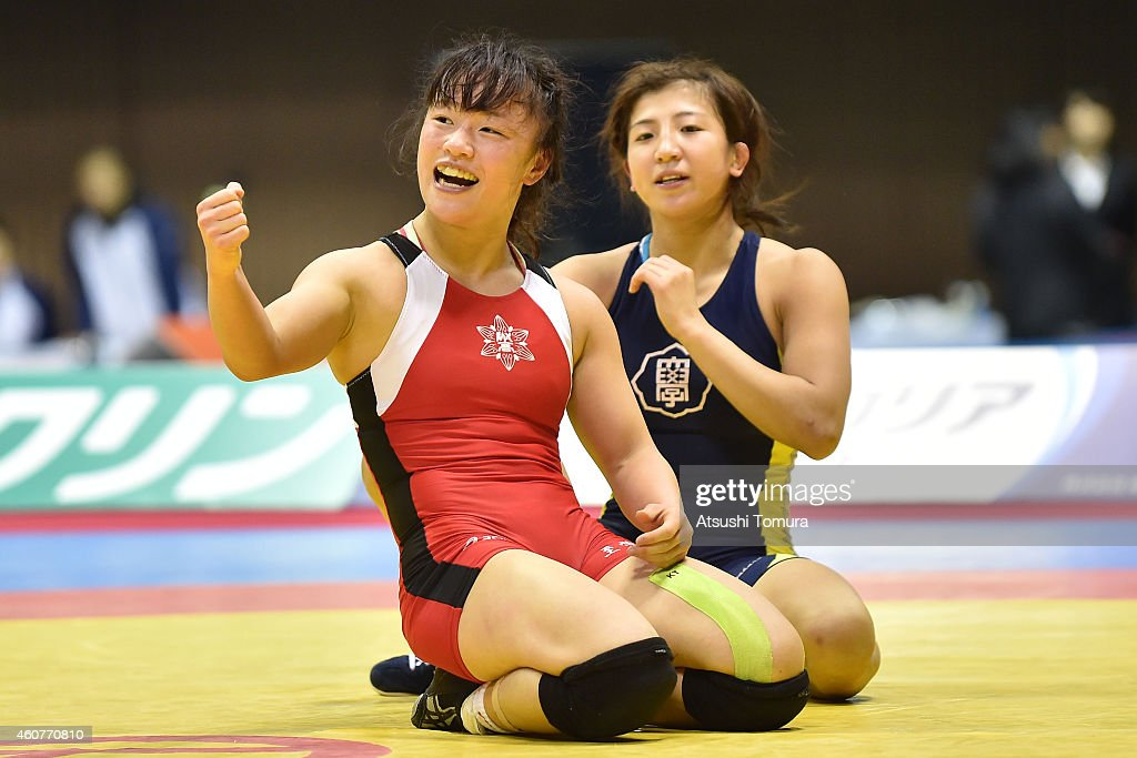 <a gi-track='captionPersonalityLinkClicked' href=/galleries/search?phrase=Eri+Tosaka&family=editorial&specificpeople=9149207 ng-click='$event.stopPropagation()'>Eri Tosaka</a> (Red) celebrates after winning the Women's 48kg free style final match against <a gi-track='captionPersonalityLinkClicked' href=/galleries/search?phrase=Yu+Miyahara&family=editorial&specificpeople=6339675 ng-click='$event.stopPropagation()'>Yu Miyahara</a> (Blue) during 2014 Emperor's Cup All Japan Wresting Championship on December 22, 2014 in Tokyo, Japan.