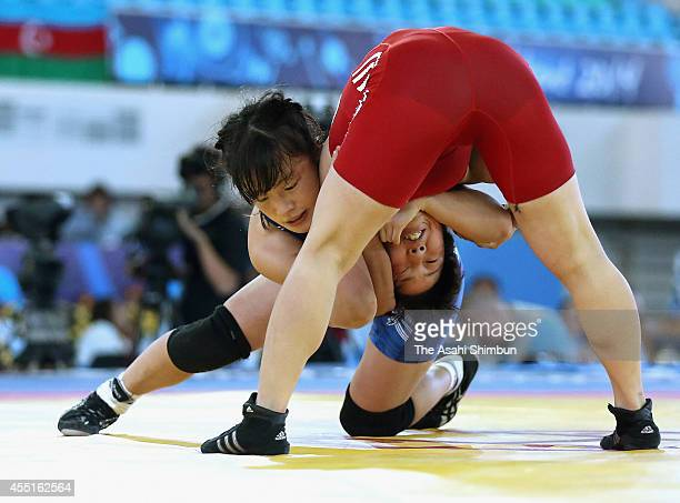 Eri Tosaka of Japan and Kim Hyon Gyong of North Korea compete in the Women's 48kg semi final match during day three of the FILA World Wrestling...